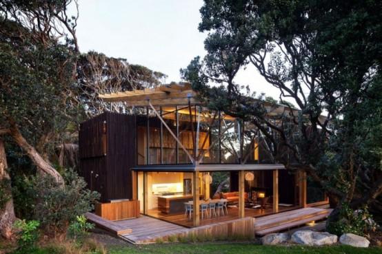 Modelo de casa moderna de madera natural arkihome for Casas de madera modernas